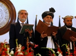 Afghanistan's new President Ashraf Ghani Ahmadzai (2nd L) stands next to Afghanistan's Chief Executive Abdullah Abdullah (L) and his deputies as he takes the oath during his inauguration as president in Kabul September 29, 2014