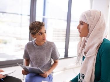 Three woman talking in an office
