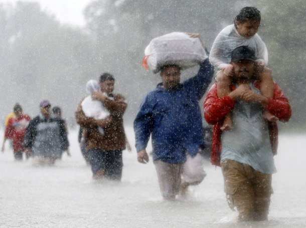Residents wade through flood waters from Tropical Storm Harvey in Beaumont Place, Houston, Texas, August 28, 2017