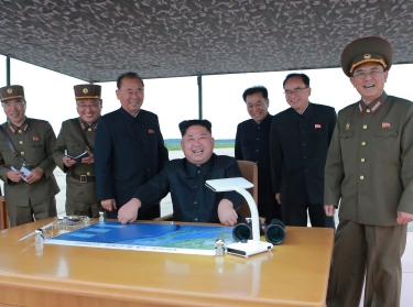 North Korean leader Kim Jong Un inspects a long and medium-range ballistic rocket launch drill in this undated photo released by North Korea's Korean Central News Agency in Pyongyang on August 30, 2017