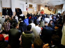 Muslims listen to a Turkish imam during Friday prayers at the Turkish Kuba Camii mosque in Cologne's district of Kalk, Germany, October 14, 2016