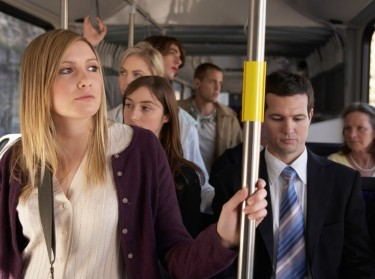 People on a bus commuting to work