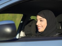 A Middle Eastern woman driving