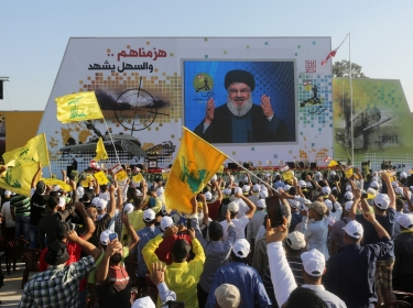 Supporters of Lebanon's Hezbollah leader Sayyed Hassan Nasrallah listen to him via a screen during a rally marking the 11th anniversary of the end of Hezbollah's 2006 war with Israel, in Khiam, Lebanon, August 13, 2017
