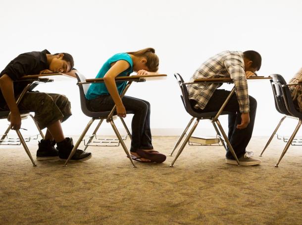 Students sleeping on their desks