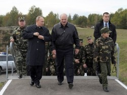 Russian President Vladimir Putin and Belarusian President Alexander Lukashenko walk to watch the closing stage of the joint war games Zapad-2013 (West-2013) at the Gozhsky firing range in Grodno, September 26, 2013