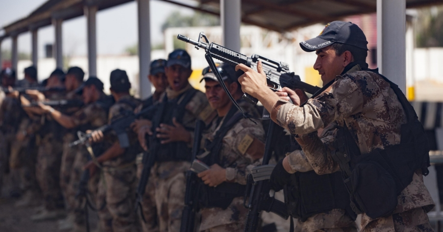 Iraqi Counter Terrorism Service soldiers perform reloading drills with their M-4 rifles during refit training near Baghdad, Iraq, July 13, 2016