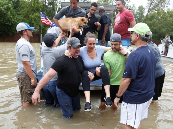A rescue boat evacuates people from the rising waters of Buffalo Bayou following Hurricane Harvey in a neighborhood west of Houston, Texas, August 30, 2017