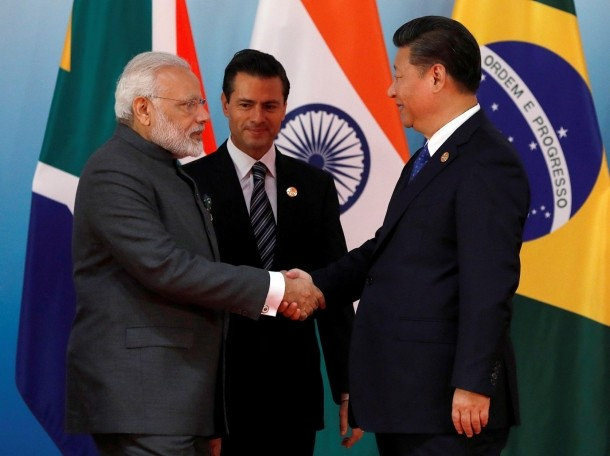 Chinese President Xi Jinping greets Indian Prime Minister Narendra Modi and Mexico's President Enrique Pena Nieto before the Emerging Market and Developing Countries meeting during the BRICS Summit, in Xiamen, China, September 5, 2017