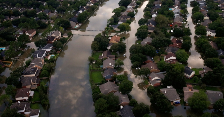 Houses are seen partially submerged in flood waters caused by Tropical Storm Harvey in Northwest Houston, Texas, August 30, 2017