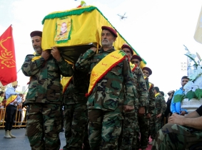 Hezbollah members carry the coffin of Hezbollah commander Fadi Shahouri, near Nabatieh in southern Lebanon, August 4, 2017