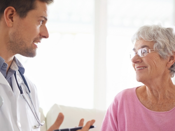 A doctor explaining something to his senior patient
