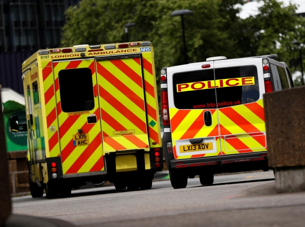 An ambulance waits next to a police car outside the emergency department at St Thomas' Hospital in central London, Britain May 12, 2017