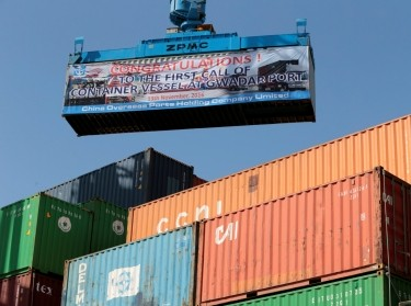 A container is loaded on to the first Chinese container ship to depart after the inauguration of the China Pakistan Economic Corridor port in Gwadar, Pakistan November 13, 2016
