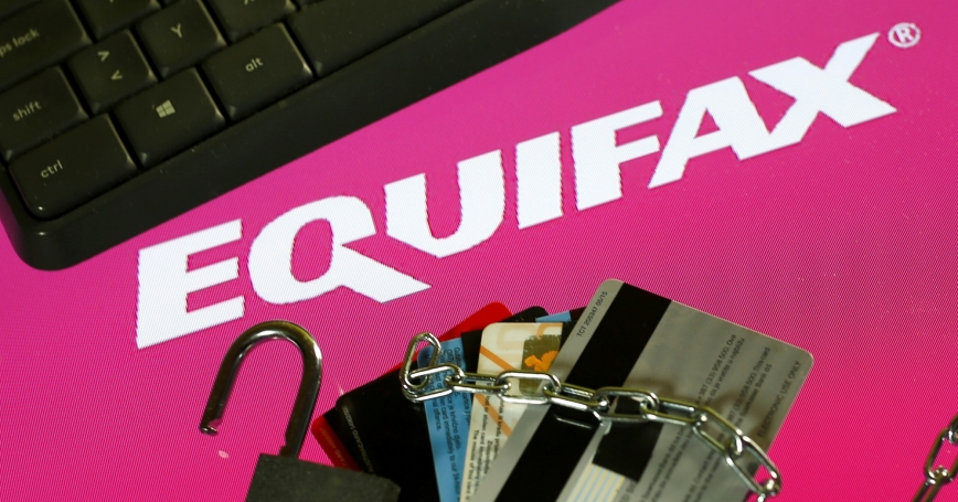 Credit cards, a chain, an open padlock, and a computer keyboard are visible next to the Equifax logo