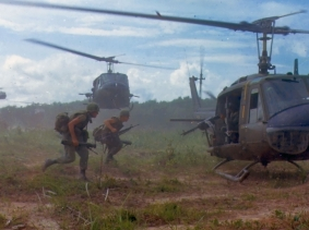 U.S. Army Bell UH-1D helicopters airlift soldiers from the Filhol Rubber Plantation area to a new staging area during Operation Wahiawa, a search and destroy mission conducted northeast of Cu Chi, South Vietnam, 1966