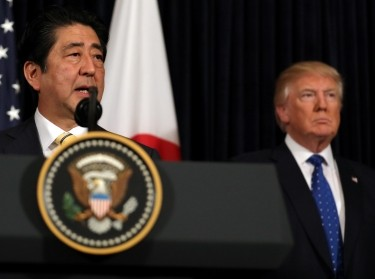 Japanese Prime Minister Shinzo Abe (left) delivers remarks on North Korea, accompanied by U.S. President Donald Trump at the Mar-a-Lago club in Palm Beach, Florida, February 11, 2017
