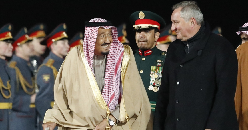 Saudi Arabia's King Salman (L) speaks with Russian Deputy Prime Minister Dmitry Rogozin (R) during a welcoming ceremony upon his arrival in Moscow, Russia, October 4, 2017