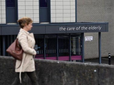 A woman walks past the elderly care department of Ulster Hospital in Belfast, Northern Ireland, June 27, 2017