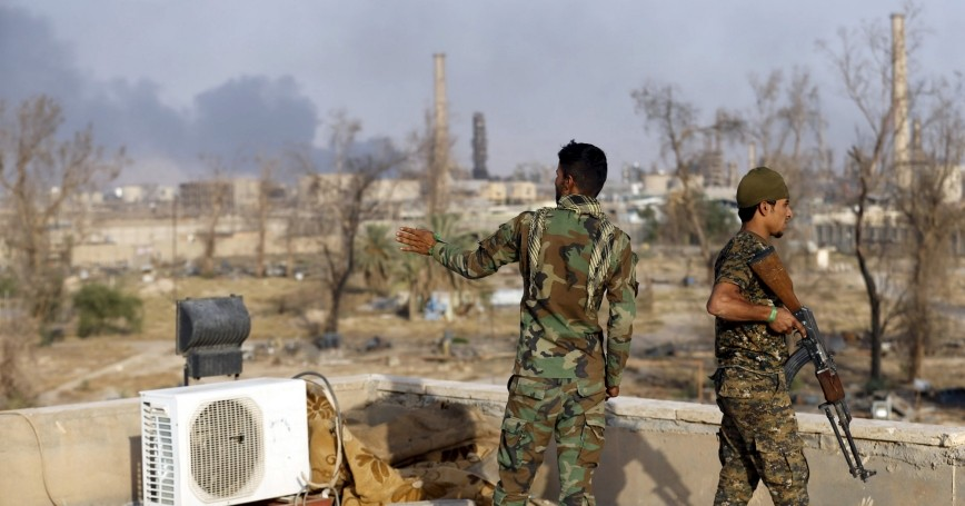 Iraqi security forces stand guard in an oil refinery, north of Baghdad, in Baiji, Iraq, October 16, 2015