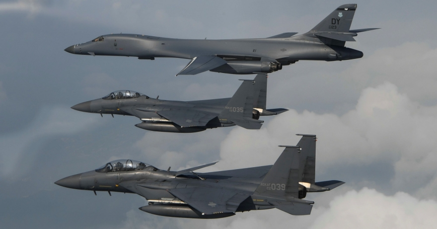 A U.S. Air Force B-1B Lancer is joined by Republic of Korea air force F-15s, during a 10-hour mission from Andersen Air Force Base, Guam, into Japanese airspace and over the Korean Peninsula, July 30, 2017