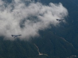 Two U.S. Air Force B-1B Lancers deployed to Andersen Air Base, Guam, fly over the Republic of Korea Sept. 21, 2016