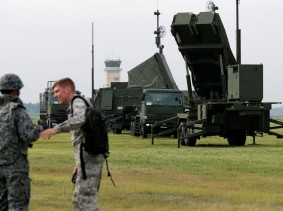 A Japan Self-Defense Forces soldier (L) talks with a U.S. Forces soldier during a drill to mobilise JSDF's PAC-3 missile unit in response to a recent missile launch by North Korea, at U.S. Air Force Yokota Air Base in Fussa on the outskirts of Tokyo, Japan, August 29, 2017