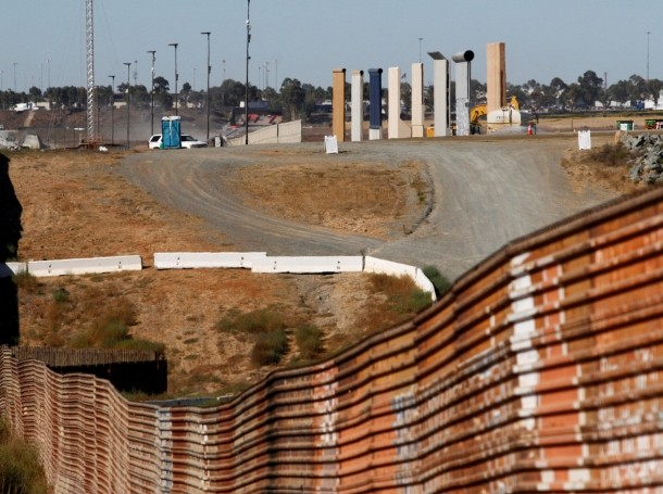 Prototypes for a U.S. border wall are shown near completion behind the current border fence near Tijuana, Mexico, October 23, 2017