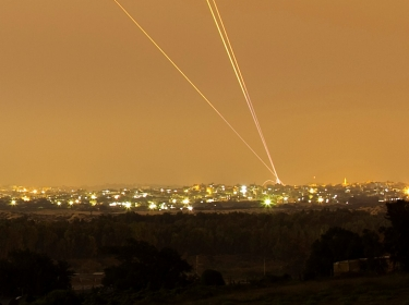 Smoke trails are seen as rockets are launched towards Israel from the northern Gaza Strip July 12, 2014