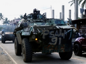 An armored personnel carrier on a highway after President Rodrigo Duterte announced the liberation of Marawi in Lanao Del Sur, Philippines, October 28, 2017