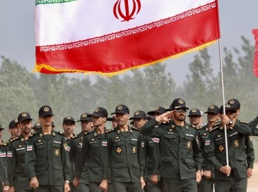 Iran's army servicemen with the national flag attend the opening ceremony of the airborne platoon competition, part of the International Army Games 2017, in Guangshui, Hubei province, China, July 30, 2017