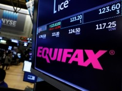 Trading information about Equifax and the company logo are displayed on a screen on the floor of the New York Stock Exchange, September 8, 2017