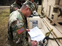 Sling load inspector checks the load plan paperwork prior to sling load operations with the 44th Expeditionary Signal Battalion March 22, 2016 at the Grafenwoehr Training Area, Germany