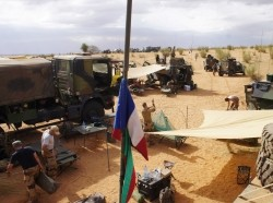 French soldiers set up camp while waiting for the delivery of a replacement piece for a vehicle in Inat, Mali, May 27, 2016