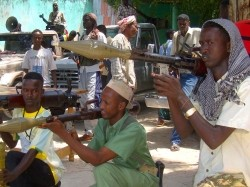 Somali fighters belonging to Ahlusunah warjama, a moderate sect fighting against the hardline Al-Shabaab insurgents, display weapons during a parade in Mogadishu, July 31, 2010