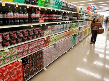 A woman walks down the soda aisle at a grocery store in Los Angeles, California, April 7, 2011