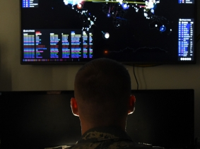 Staff Sgt. Auguste Archer, 35th Communications Squadron cyber security technician, uses a program to monitor hacker attempts across the world