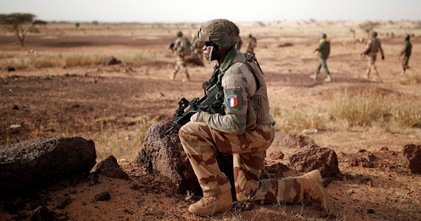 Troops from the Malian Armed Forces and French soldiers conduct a joint patrol during the regional anti-insurgent Operation Barkhane in Inaloglog, Mali, October 17, 2017.