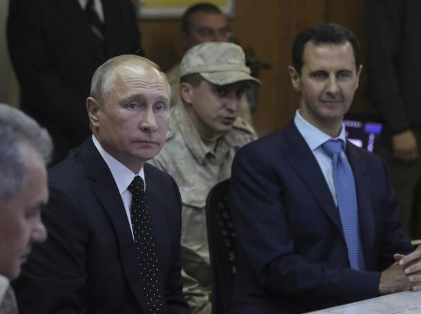 Russian President Vladimir Putin (2nd L) and Syrian President Bashar al-Assad (R) visit the Hmeymim air base in Latakia Province, Syria, December 11, 2017