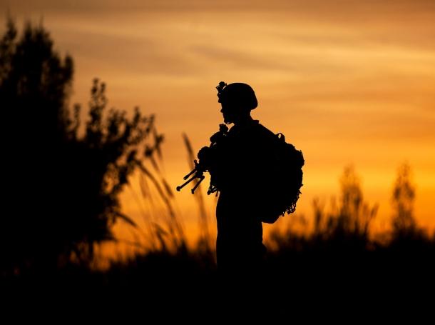 U.S. Marine Pfc. Garrett Reed watches over a bridge during a security patrol in Garmsir, Afghanistan, December 7, 2011