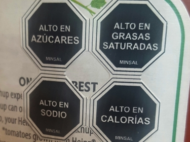 A food label in Chile indicates that a product has an excessive quantity of salt, sugar, calories, and fat