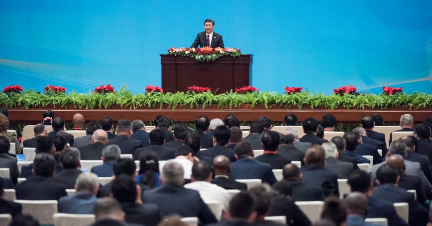 "China's President Xi Jinping speaks at the opening ceremony of the ""CPC in dialogue with world political parties"" high-level meeting, at the Great Hall of the People in Beijing, China, December 1, 2017"