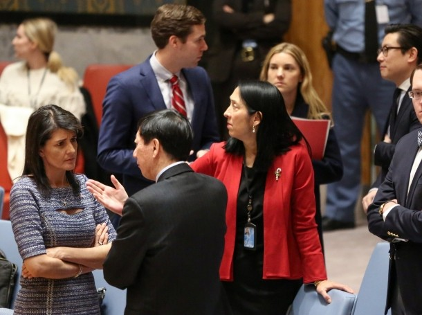 U.S. Ambassador Nikki Haley speaks with Chinese Deputy Ambassador Wu Haitao ahead of the United Nations Security Council session on imposing new sanctions on North Korea, in New York, December 22, 2017