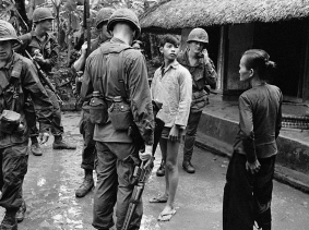 American soldiers and Vietnamese civilians in a village during the Vietnam War in October 1967 in Vietnam