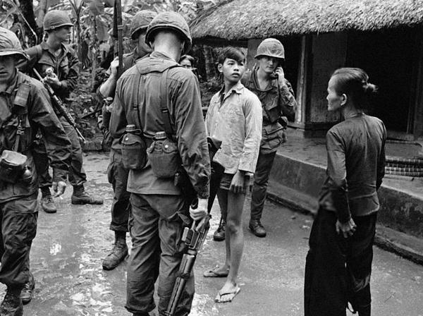 American soldiers and Vietnamese civilians in a village during the Vietnam War in October 1967 in Vietnam