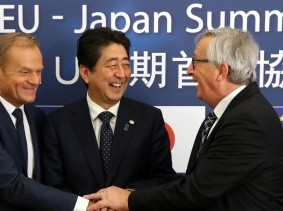 Japan's Prime Minister Shinzo Abe (center) is welcomed by European Council President Donald Tusk (left) and European Commission President Jean-Claude Juncker at a European Union-Japan summit, Brussels, Belgium, July 6, 2017