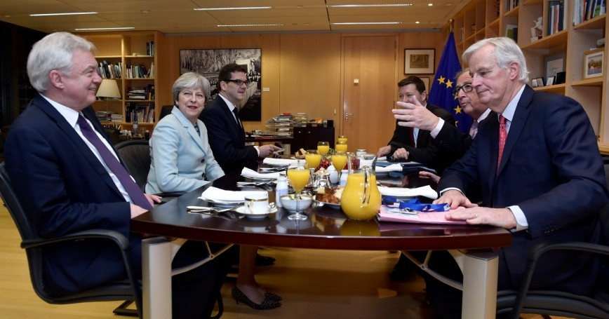 Britain's Secretary of State for Exiting the European Union David Davis (L), Britain's Prime Minister Theresa May, European Commission President Jean-Claude Juncker and European Union's chief Brexit negotiator Michel Barnier (R) meet at the European Commission in Brussels, Belgium December 8, 2017
