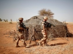 French soldiers of the 13th engineering regiment inspect the perimeter of a touareg home near Tin Hama, Mali, October 20, 2017