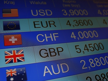 Rates of currencies are displayed at a currency exchange in Warsaw, Poland, on June 24, 2016, the day after the United Kingdom voted to leave the European Union