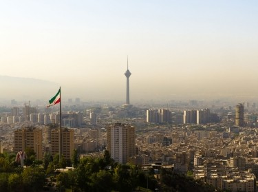 Tehran skyline with Iranian flag and Milad Tower